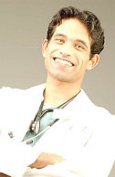 smiling doctor with stethoscope around his neck